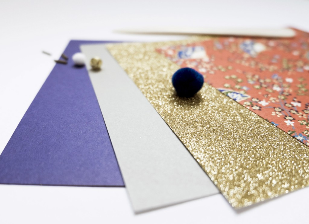 Pretty paper, some beads, some thread, a little bell