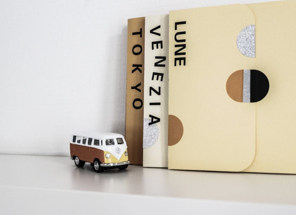 Homemade Travel Books and mini-bus on the shelve