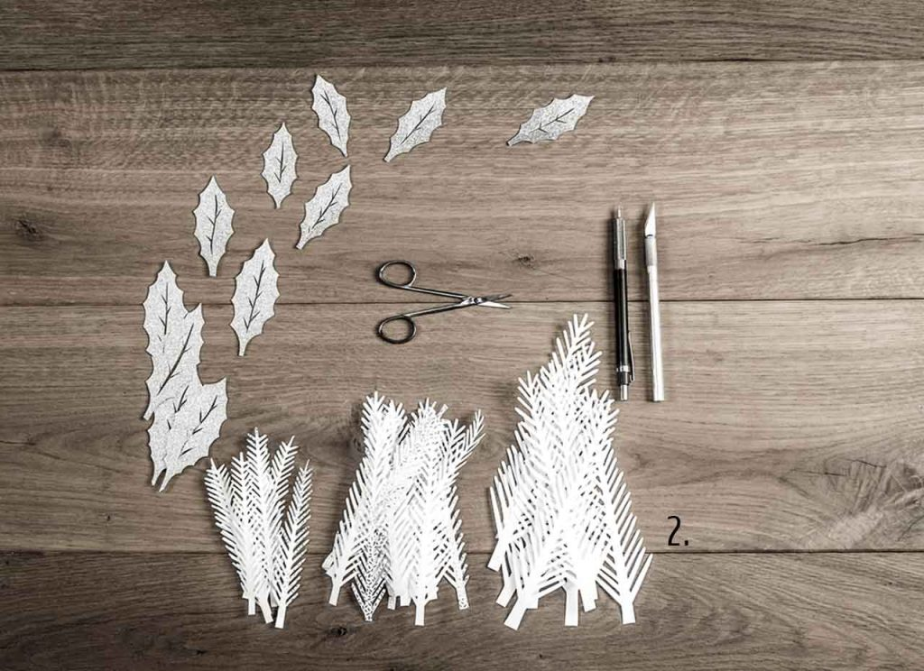 Holly branches and leaves in paper for decoration