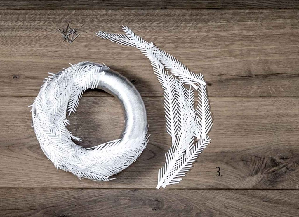 Make your own wreath with holly paper branches and leaves